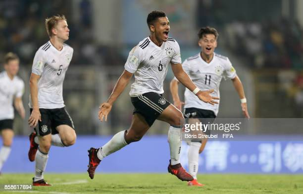 Noah Awuku of Germany celebrates with team mates after scoring his team's second the winning goal during the FIFA U17 World Cup India 2017 group C...