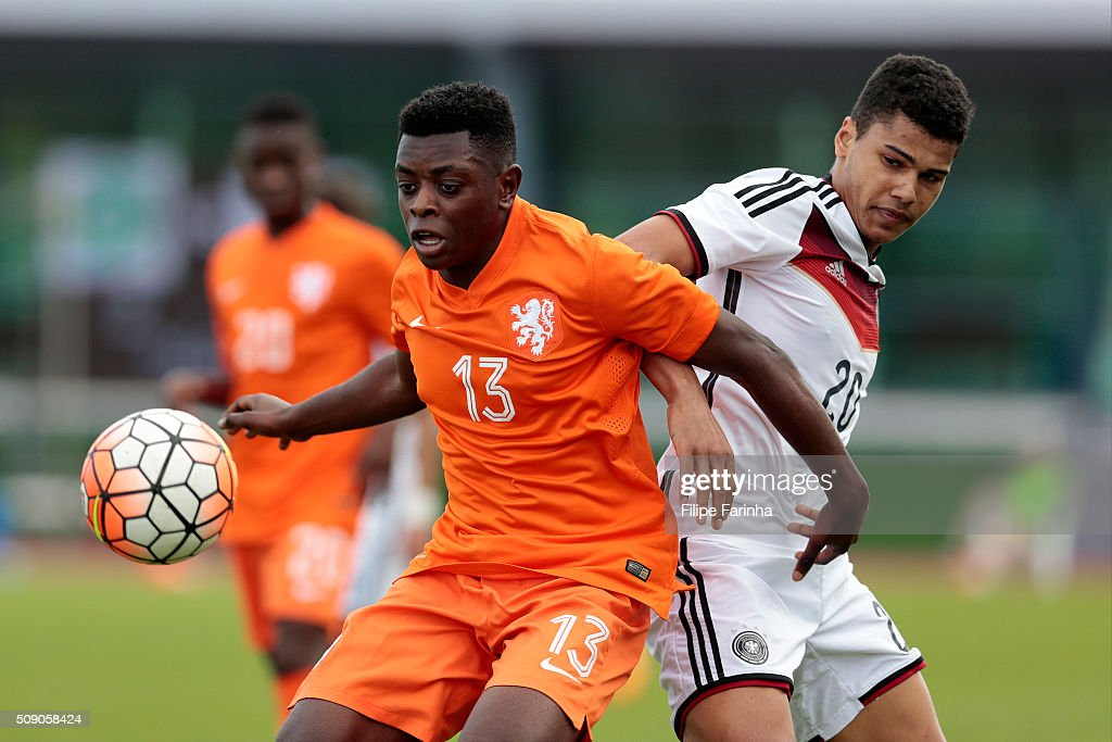 Noah Awuku of Germany challenges Kushi Elton of Netherlands during the UEFA Under16 match between U16 Germany v U16 Netherlands on February 8, 2016 in Vila Real de Santo Antonio, Portugal. (Photo by Filipe Farinha/Bongarts/Getty Images