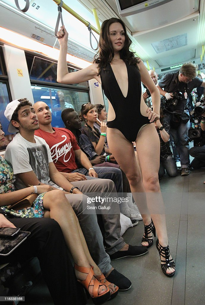 Noah Becker (L), son of former German tennis great Boris Becker, looks at a model wearing a bathing suit he designed during the Chevrolet Underground Catwalk 2011 on July 6, 2011 in Berlin, Germany. The event took place in an U-Bahn commuter train and coincides with the Mercedes-Benz Fashion Week.