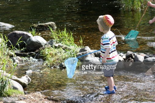 Noah catching fish with a net stock photo getty images for Fish catching net