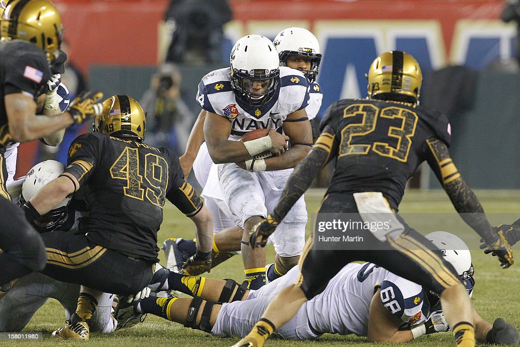 Noah Copeland #34 of the Navy Midshipmen carries the ball during a game against the Army Black Knights on December 8, 2012 at Lincoln Financial Field in Philadelphia, Pennsylvania. The Navy won 17-13.