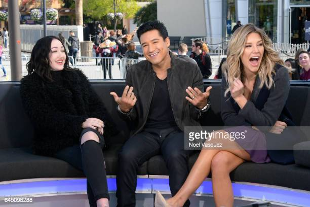 Noah Cyrus Mario Lopez and Charissa Thompson visit 'Extra' at Universal Studios Hollywood on February 24 2017 in Universal City California