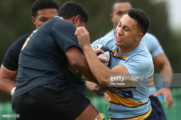 Noah Foster of Mt Albert is tackled during the schoolboy First XV rugby match between Mt Albert Grammar and Auckland Grammar at Mt Albert Grammar...