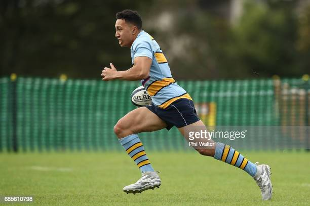 Noah Foster of Mt Albert runs the ball during the schoolboy First XV rugby match between Mt Albert Grammar and Auckland Grammar at Mt Albert Grammar...
