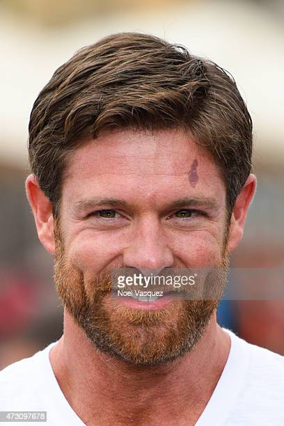Noah Galloway visits 'Extra' at Universal Studios Hollywood on May 12 2015 in Universal City California