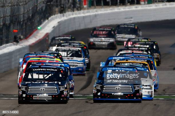 Noah Gragson driver of the Switch Toyota and Christopher Bell driver of the SiriusXM Toyota lead the field past the green flag to start the NASCAR...