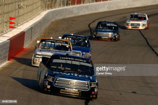 Noah Gragson driver of the Switch Toyota leads Kaz Grala driver of the Kiklos Greek Extra Virgin Olive Oil Chevrolet during the NASCAR Camping World...