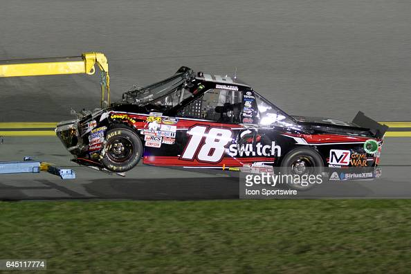 Noah Gragson's truck is towed back to the garage after a 1st lap wreck during NASCAR Camping World Truck Series NextEra Energy Resources 250 on...