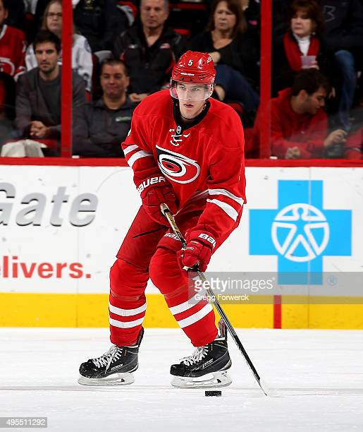 Noah Hanafin of the Carolina Hurricanes controls the puck on the ice against the Tampa Bay Lightning during a NHL game at PNC Arena on November 1...