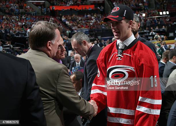 Noah Hanifin greets the team after being picked fifth overall by the Carolina Hurricanes during Round One of the 2015 NHL Draft at BBT Center on June...