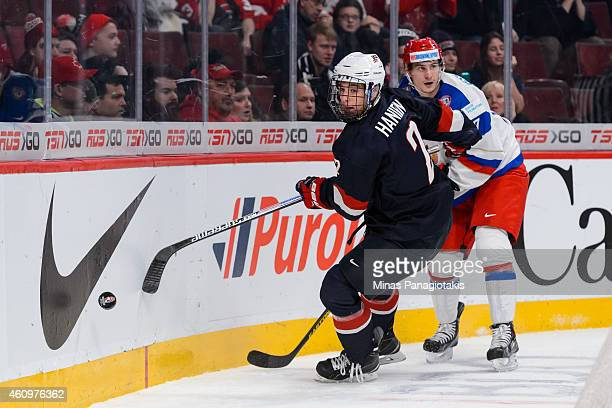 Noah Hanifin of Team United States goes after the puck behind the net in a quarterfinal round during the 2015 IIHF World Junior Hockey Championships...