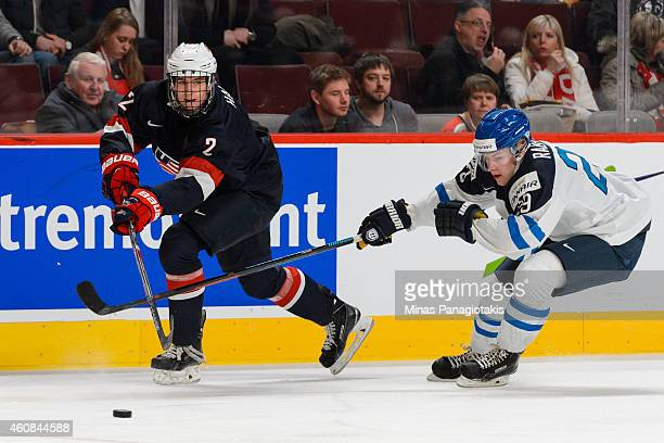 Noah Hanifin of Team United States passes the puck near Otto Rauhala of Team Finland during the 2015 IIHF World Junior Hockey Championship game at...