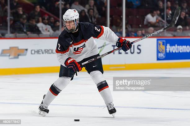 Noah Hanifin of Team United States prepares to shoot the puck during the 2015 IIHF World Junior Hockey Championship game against Team Germany at the...