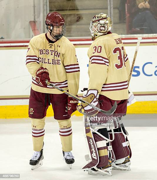 Noah Hanifin of the Boston College Eagles talks to teammate Thatcher Demko during NCAA hockey against the Boston University Terriers at Kelley Rink...
