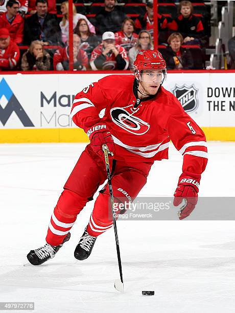Noah Hanifin of the Carolina Hurricanes carries the puck during a NHL game against the the Anaheim Ducks at PNC Arena on November 16 2015 in Raleigh...