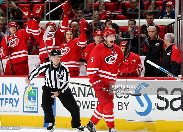 Noah Hanifin of the Carolina Hurricanes celebrates after scoring his first NHL goal during a game against the Anaheim Ducks at PNC Arena on November...