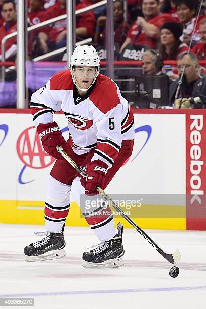 Noah Hanifin of the Carolina Hurricanes controls the puck in the second period against the Washington Capitals during an NHL game at Verizon Center...
