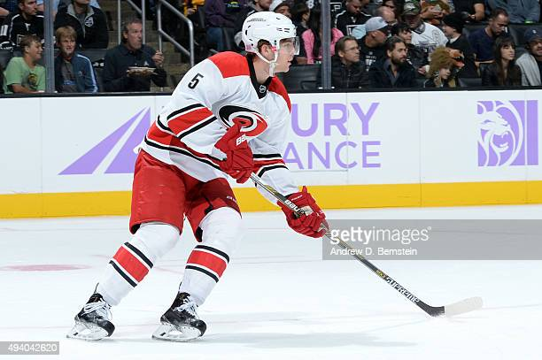 Noah Hanifin of the Carolina Hurricanes handles the puck during a game against the Los Angeles Kings at STAPLES Center on October 23 2015 in Los...