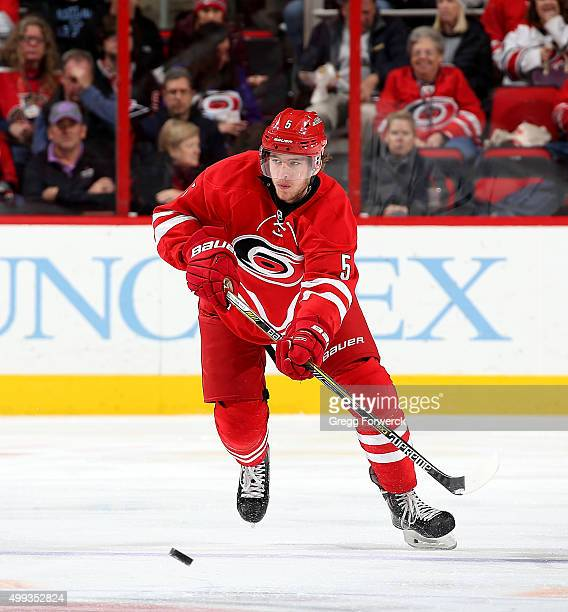 Noah Hanifin of the Carolina Hurricanes passes the puck during a NHL game against the Edmonton Oilers at PNC Arena on November 25 2015 in Raleigh...