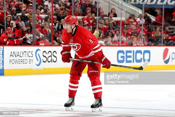 Noah Hanifin of the Carolina Hurricanes prepares for a faceoff during a NHL game against the Detroit Red Wings at PNC Arena on October 10 2015 in...