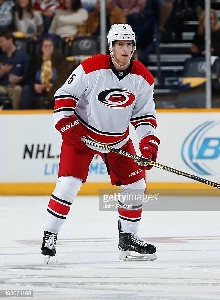 Noah Hanifin of the Carolina Hurricanes skates against the Nashville Predators during an NHL game at Bridgestone Arena on October 8 2015 in Nashville...