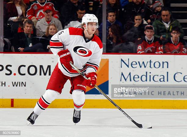 Noah Hanifin of the Carolina Hurricanes skates against the New Jersey Devils at the Prudential Center on December 29 2015 in Newark New Jersey The...
