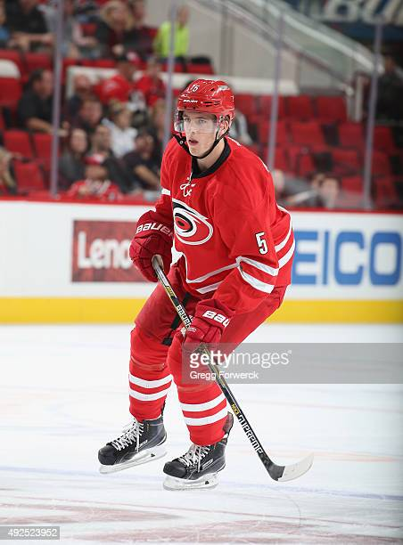 Noah Hanifin of the Carolina Hurricanes skates for position during a NHL game against the Florida Panthers at PNC Arena on October 13 2015 in Raleigh...