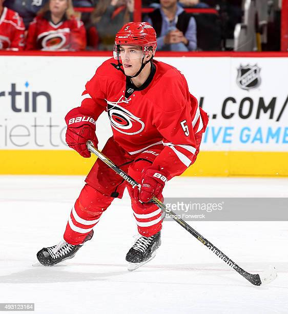Noah Hanifin of the Carolina Hurricanes skates for position during a NHL game against the Detroit Red Wings at PNC Arena on October 10 2015 in...