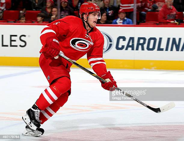 Noah Hanifin of the Carolina Hurricanes skates up the ice during a NHL game against the Detroit Red Wings at PNC Arena on October 10 2015 in Raleigh...