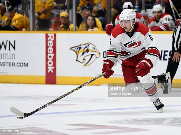Noah Hanifin of the Carolina Hurricanes skates with the puck against the Nashville Predators at Bridgestone Arena on October 8 2015 in Nashville...