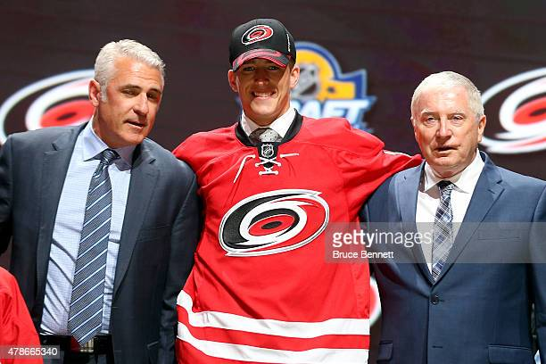 Noah Hanifin poses after being selected fifth overall by the Carolina Hurricanes in the first round of the 2015 NHL Draft at BBT Center on June 26...