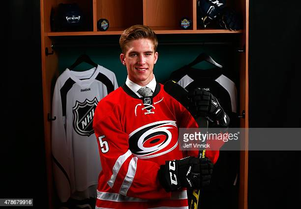 Noah Hanifin poses for a portrait after being selected fifth overall by the Carolina Hurricanes during Round One of the 2015 NHL Draft at BBT Center...