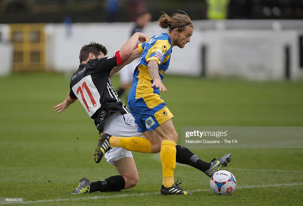 Noah Keats of Bath City (R) and Stuart Sinclair of Salisbury contest the ball during the FA Cup fourth qualifying round match between Bath City and Salisbury at Twerton Park on October 26, 2013 in Bath, England.