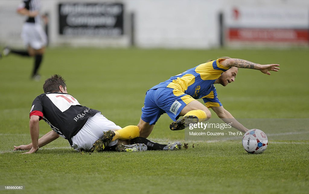Noah Keats of Bath City (L) tackles Stuart Sinclair of Salisbury during the FA Cup fourth qualifying round match between Bath City and Salisbury at Twerton Park on October 26, 2013 in Bath, England.