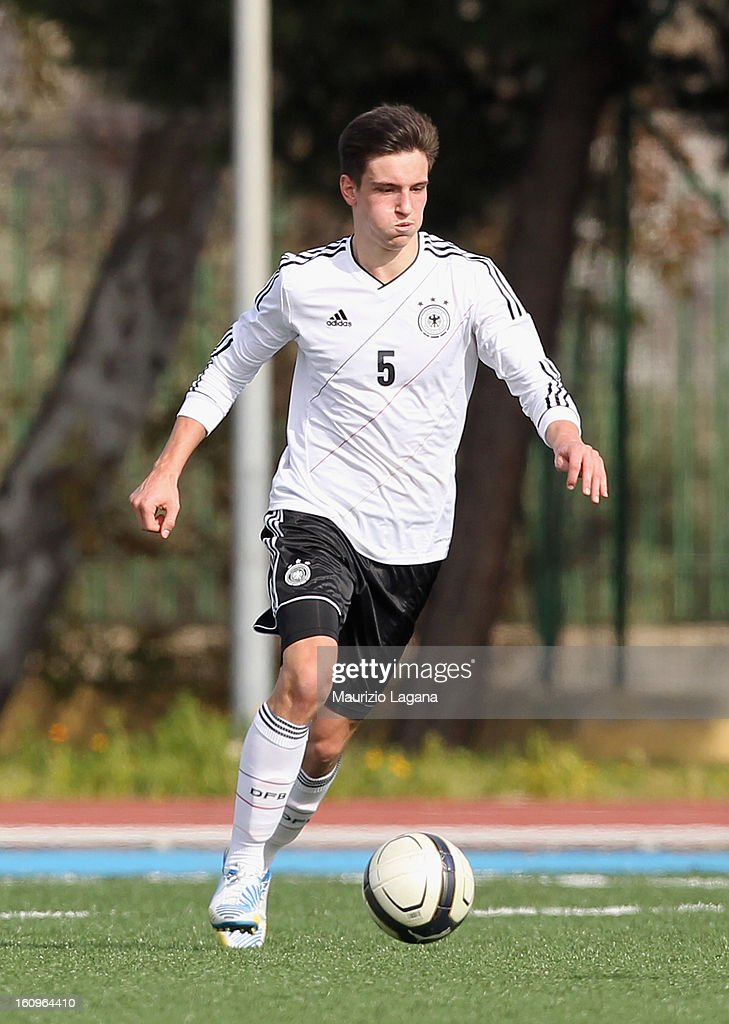 Noah Korczowsky of Italy competes for the ball with of Germany during Under 19 International Friendly match between Italy and Germany at Stadio Comunale San Pio on February 6, 2013 in Santo Spirito near Bari, Italy.