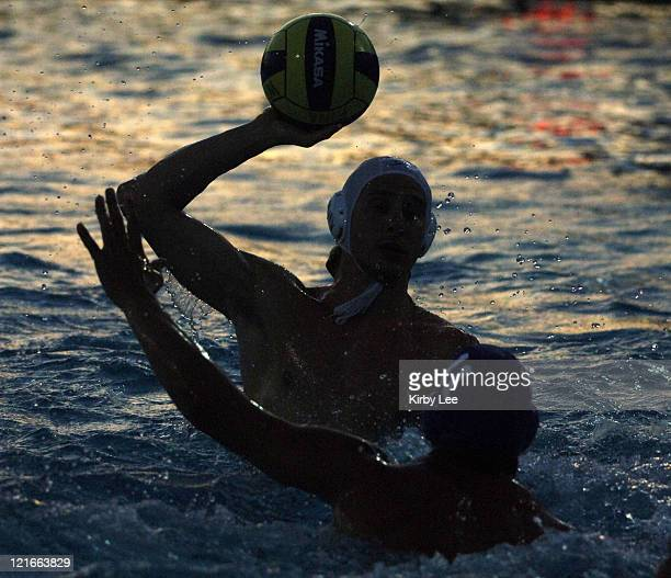 Noah Miller of Canada is a silhouette as he is defended by Brazil's Daniel Mameri in FINA World League semifinal at the USA Water Polo National...