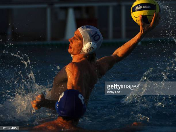 Noah Miller of Canada takes a shot during 138 victory over Brazil in FINA World League Semifinal at the USA Water Polo National Training Center in...