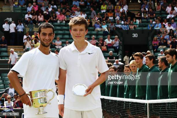 Noah Rubin of the United States and Stefan Kozlov of the United States pose with their respective trophies after the Boys' Singles Final match on day...