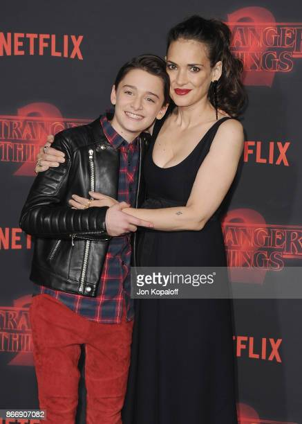 Noah Schnapp and Winona Ryder arrive at the premiere of Netflix's 'Stranger Things' Season 2 at Regency Bruin Theatre on October 26 2017 in Los...