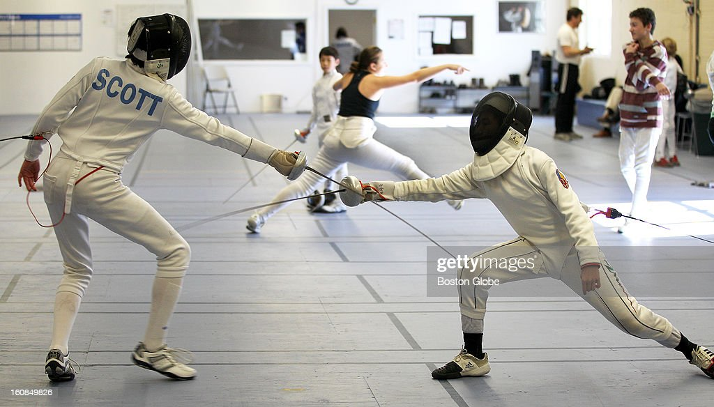 Noah Scott, 13, left, of Milton, and Zhengrong Chen, 13, of Belmont, fence as Olympia Fencing Center holds an open house (starting at 11:00 am), on Sunday, January 27, 2013. It is an épée-only club. An épée is a blunted point dueling sword.