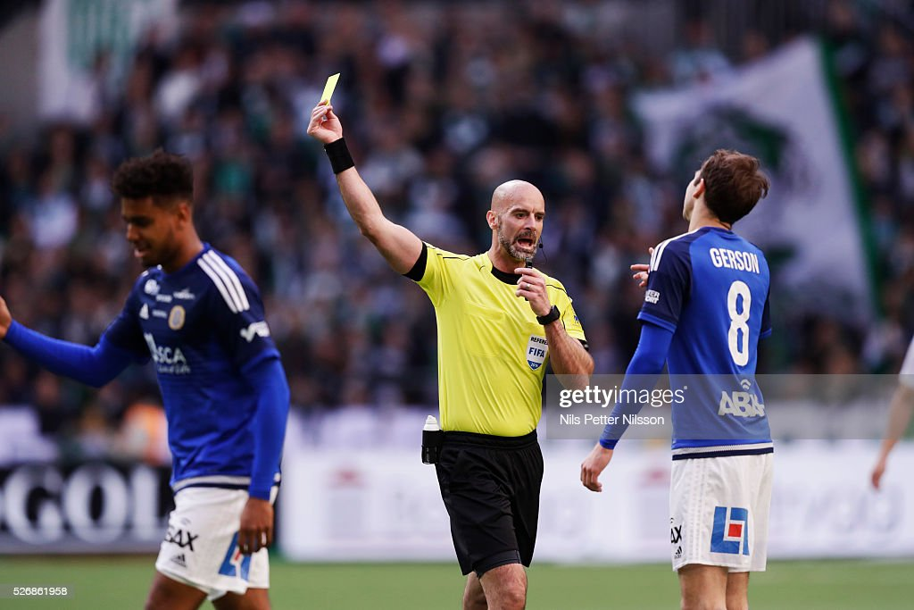 Noah Sonko Sundberg of GIF Sundsvall is shown a yellow card by referee Stefan Johannesson during the Allsvenskan match between Hammarby IF and GIF Sundsvall at Tele2 Arena on May 1, 2016 in Stockholm, Sweden.