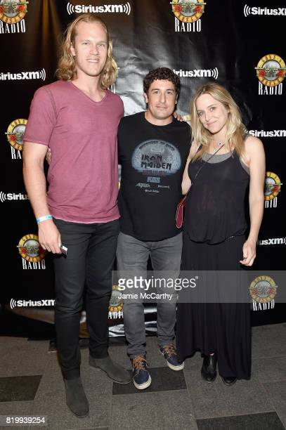 Noah Syndergaard Jason Biggs and Jenny Mollen attend the SiriusXM's Private Show with Guns N' Roses at The Apollo Theater before band embarks on next...