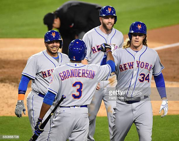 Noah Syndergaard of the New York Mets celebrates his three run homerun and second homerun of the game with Eric Campbell Rene Rivera and Curtis...