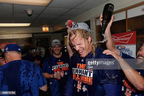 Noah Syndergaard of the New York Mets celebrates in the locker room with his teammates after defeating the Chicago Cubs in game four of the 2015 MLB...