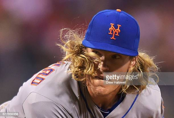Noah Syndergaard of the New York Mets has his hair fly in his face while delivering a pitch in the seventh inning against the Philadelphia Phillies...