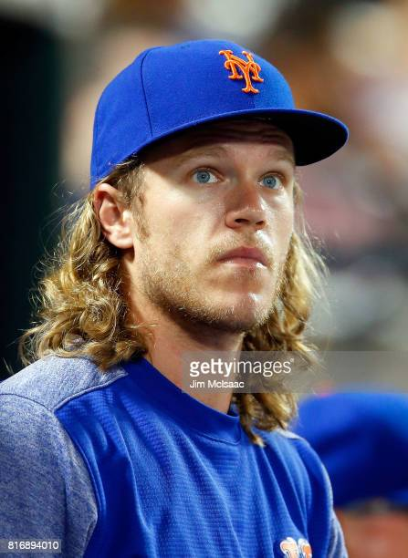 Noah Syndergaard of the New York Mets looks on from the dugout during the eighth inning against the St Louis Cardinals on July 17 2017 at Citi Field...