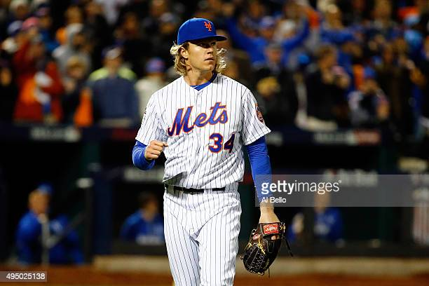 Noah Syndergaard of the New York Mets reacts against the Kansas City Royals during Game Three of the 2015 World Series at Citi Field on October 30...