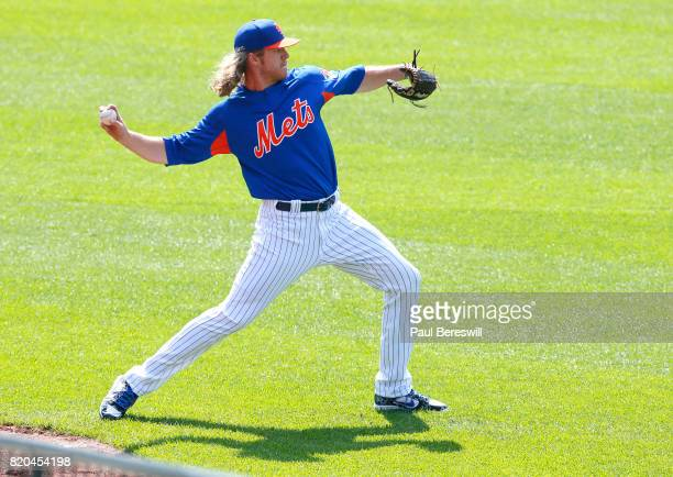 Noah Syndergaard of the New York Mets throws a ball to teammate Matt Harvey as the two injured starters threw baseballs to each other for the first...