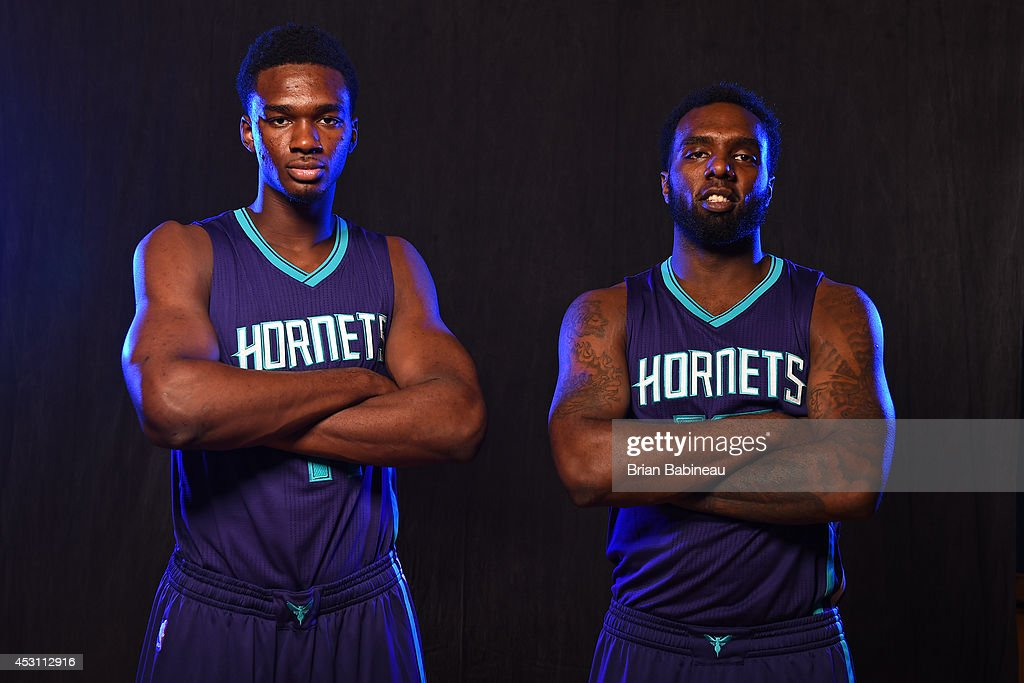 <a gi-track='captionPersonalityLinkClicked' href=/galleries/search?phrase=Noah+Vonleh&family=editorial&specificpeople=9612442 ng-click='$event.stopPropagation()'>Noah Vonleh</a> #11 and <a gi-track='captionPersonalityLinkClicked' href=/galleries/search?phrase=P.J.+Hairston&family=editorial&specificpeople=7621185 ng-click='$event.stopPropagation()'>P.J. Hairston</a> #19 of the Charlotte Hornets poses for a portrait during the 2014 NBA rookie photo shoot on August 3, 2014 at the Madison Square Garden Training Facility in Tarrytown, New York.