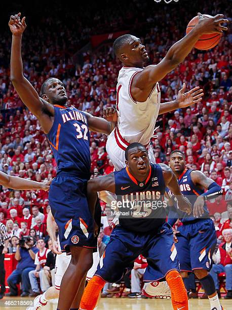 Noah Vonleh of the Indiana Hoosiers reaches for a rebound over the back of Kendrick Nunn of the Illinois Fighting Illini at Assembly Hall on January...